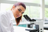 Brunette posing with a microscope — Stock Photo