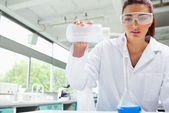 Female science student pouring liquid — Stock Photo