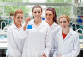 Lab partners posing with a flask — Stockfoto