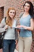 Portrait of a student helping a classmate — Stock Photo
