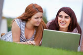 Young women working with a notebook — Stock Photo