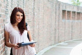 Smiling student with her notes — Stock Photo