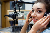 Close up of a young radio host posing — Foto Stock
