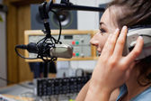 Smiling radio host speaking — Stock Photo