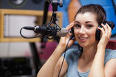 Smiling radio host posing — Stock Photo
