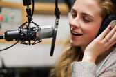 Close up of a singer recording a track — Stock Photo