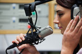 Close up of a cute singer recording a track — Stock Photo