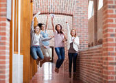 Students jumping with their results — Stock Photo