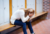 Depressed student sitting on a bench — Stock Photo