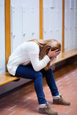 Portrait of a depressed student sitting on a bench — Stock Photo