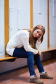 Portrait of a sad student sitting on a bench — Stock Photo