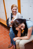 Student making fun of her classmate — Foto de Stock