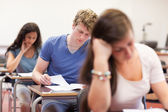 Good looking students doing an assignment — Stock Photo