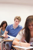 Portrait of young students having a test — Stock Photo
