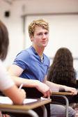 Oturan bir öğrenci portresi — Stok fotoğraf