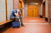 Sad student sitting on a bench — Stock Photo