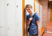 Student leaning on a locker — Stock Photo