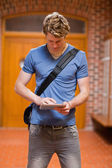 Portrait of a handsome student using a tablet computer — Stock Photo