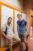 Portrait of handsome students standing up — Stock Photo