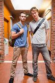 Portrait of handsome students posing — Stock Photo