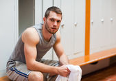 Young sports student sitting on a bench — Stock Photo