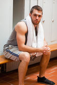 Portrait of a sports student sitting on a bench — Stock Photo