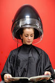 Portrait of a woman under a hairdressing machine — Stock Photo