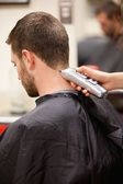 Portrait of man having a haircut — Stock Photo