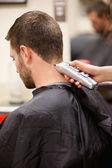 Portrait of man having a haircut — Stock Photo