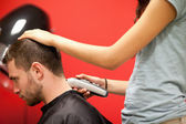 Male student having a haircut — Stock Photo