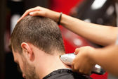 Close up of a male student having a haircut — Stock Photo