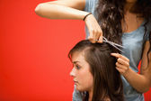 Student hairdresser cutting hair — Stock Photo