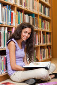 Portrait of a female student with a book — Stock Photo