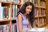 Student holding a book — Stock Photo
