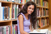 Young student holding a book — Stock Photo