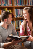 Portrait of students with a book — Stock Photo