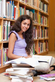 Portrait of a happy student with a book — Stock Photo