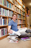 Portrait of a student doing research while his classmate is read — Stock Photo