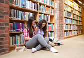 Female students with a book — Stock Photo