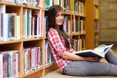 Cute female student holding a book — Stock Photo