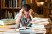 Tired student having a lot to read — Stock Photo