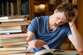 Tired man reading a book — Stock Photo
