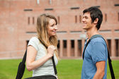 Young student couple flirting — Стоковое фото