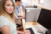 Cute student with a computer — Stock Photo