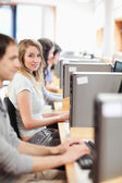 Portrait of fellow students in an IT room — Stock Photo