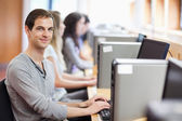 Smiling fellow students in an IT room — Stock Photo