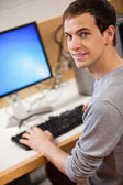 Portrait of a male student using a computer — Stock Photo