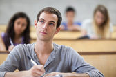 Students taking notes in an amphitheater — Stock Photo