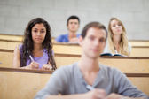 Focused students listening during a lecture — Stock Photo