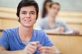 Student listening to a lecturer — Stock Photo